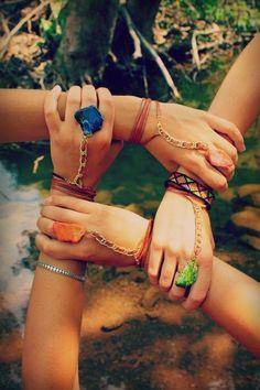 Glastonbury Festival Fashion Inspiration.  Ring-Wrist wear. Bright stone and gold chain bracelete. Friends holding hands