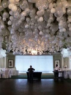Beautiful idea for a wedding reception. Place a marble in each balloon before blowing up so they hang upside down. LOVE THIS