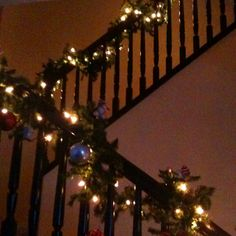 Garland with lights on a staircase makes the Holidays that much better :)
