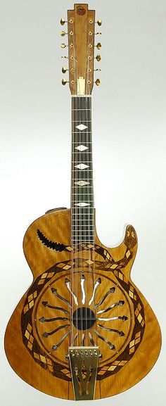 """""""Snake Motif"""" Resonator Guitar in cherry. I've had this thing for resonators lately.Not exactly a Ukulele but nice just the same. Guitar Art, Cool Guitar, Piano, Gretsch, 12 String Guitar, Resonator Guitar, Rick E, Essayist, Beautiful Guitars"""