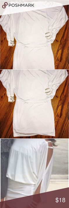 Gorgeous White Stretchy Dress by Arden B. Sz XS This mini dress is both comfortable and tasteful, but also sexy too! It has a blousy top with partially open arms (exaggerated cold shoulder). The shoulders each have three bands of rhinestones, as do the wrists. No stones are missing. It's shorter in length, so it best fits a petite or regular size. Perfect for many occasions.. homecoming?.. winter ball?.. bridal shower?..cruise? Arden B Dresses Mini