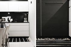 Musta välitila valkoisessa keittiössä.