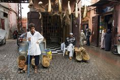 Shopkepper and his son outside their medicine shop selling natural remedies. Marrakesh