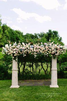 Custom floral feature arch by Rachel A. Clingen.