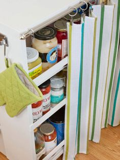 Utilize Rolling Storage - just a eye- screw and a cafe- rod is all you need to hide the clutter.