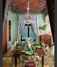 Accent color bohemian dining room design with an oriental-Indian touch