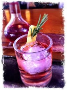 Rosemary-lemon vodka sour, from Camper English on FineCooking.
