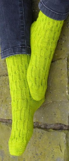 This pattern is a variation of ribbed socks with simple cables to add a little more interest to both the socks and the knitting of them. They have a very springy fabric - Boing Boing!The pattern is written for knitting toe-up/magic loop but also includes information for knitting cuff down - they will look the same whichever way they are knit. (The pattern has been tested both ways).A mini gusset allows a little more ease around the instep and the extra stitches are incorporated into the ...