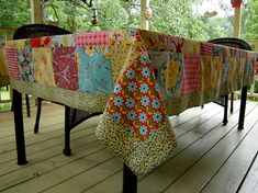 Cotton Tablecloth, using twenty- four different fabrics, twenty-three fabrics for the squares and one additional fabric for the border. Tablecloth measures 59X91 inches, fits a table up to 42X72 inches. Squares are 6 inches, and border is 2 inches wide. I used an eclectic