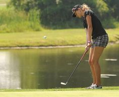 Shelby Thompson chips from the first cut on the first hole of Thursday's First National Bank Jr Golr Tour event at Oak Shadows Golf Course.