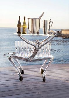 Bar Cart, Water Jug, Champagne Cooler & Champagne Glasses all available from Carrol Boyes