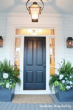 Love these dark grey planters with ferns, hydrangeas and sweet potatoe vine. Elegant front door look Grey Front Doors, Solid Doors, Front Door Colors, Black Doors, Front Door Planters, Front Door Porch, House Front, Front Entry, Southern Living Homes