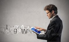 Communicate through technology by ollyi. Young businessman using a tablet pc with letters and numbers coming out from it