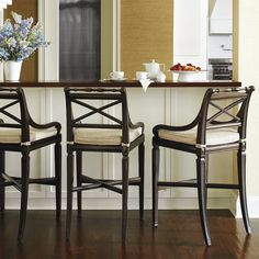 The simple beauty of judiciously selected, timeless elements. The solid mahogany frame of our exclusive Pavilion Bar Stool is expertly crafted with a    lathe-turned top rail, sloped scrolled arms and an X back, paired with a woven rattan seat.            Pecan, Ebonized Black, Mahogany or White finish                X-shaped stretcher    *This offer is not valid with other promotional offers, on previous purchases or replacement orders.