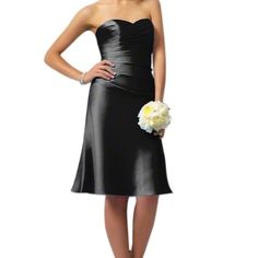 Alfred Angelo cocktail dress! For Prom/Bridesmaids Alfred Angelo black cocktail length dress! Perfect for prom or a bridesmaid dress has an a-line cut in a beautiful satin. Style 7041S features a sweetheart neckline and lace up back. I wore this once as a bridesmaids dress. Great fit and comfortable. It is size 8 but adjustable because of the lace up back. I was a size 4 when I wore this and it was perfect. Perfect for any special occasion🎀 Alfred Angelo Dresses Prom