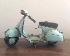 CLOSET SHELF ACCESSORY: Vespa scooter sculptures  - Would also be adorable on the vanity or dresser near a framed print with the Vespa in it.