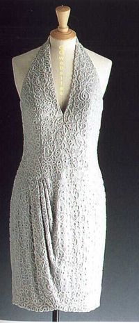 Designed by Catherine Walker. Gray halter neck dress embroidered in a scroll pattern with glass beads. Diana wore this short, halter dress in 1995 at a gallery opening. $77,300.00 Originally purchased by Fashion Cafe. Displayed at their flagship restaurant (behind glass) in NY. Also displayed in Milan and London.
