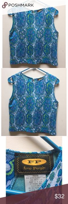☀️EUC Free People Floral Blouse Rare Vintage 1992 RARE 1992 Vintage Free People Floral Bohemian Boho Blue & Green Sleeveless Blouse Knit Tank Top with neck clasp in back, in excellent used condition, size medium, no stains holes or marks. Free People Tops Blouses