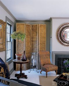 An antique timber screen gives life to a plain corner
