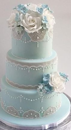 This cake was for a beautiful wedding in a barn in Gloucester. I love the delicate feel that comes from the lace overlaying the pale blue sugarpaste.