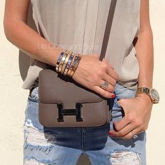 Up Close and Stylish @upcloseandstylish Instagram photos   Webstagram Up Close and today - ripped boyfriend jeans (very old), #Hermes Constance bag and #Cartier bracelets, rings and watch. Full outfit to come. (17 February 2013)