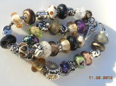 My two current bracelets in a pileup! From a great collector on Trollbeads Gallery Forum! http://trollbeadsgalleryforum.ning.com/photo/my-two-current-bracelets-in-a-pileup?context=latest#