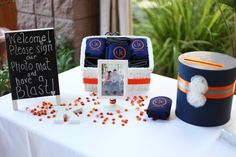 Guest book table decor and koozie favors!