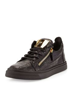 Giuseppe Zanotti crocodile-embossed leather sneaker. Golden hardware and tonal topstitching. Lace-up front with functional side zips. Engraved logo plate at tongue. Zip pull detail at back of heel. Le