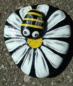 Flower & been painted rock