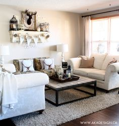Beautiful neutral living room - love the cozy throws and deer pillows eclecticallyvintage.com