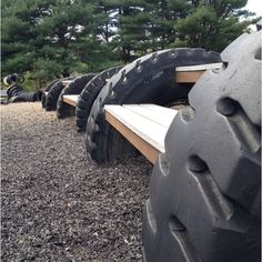 Recycled tire playground. Hook it to the kids playground?