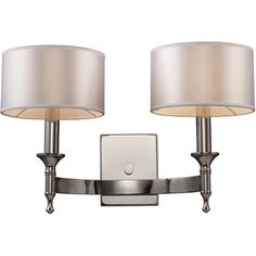 Polished nickel wall sconce with silver drum shades.   Product: Wall sconce  Construction Material: Fabric and metal Wilton wall sconce