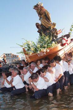 Fishermans carrying del Carmen Holy Virgin to the sea, O Grove, Pontevedra - Spain