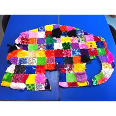 Elmer the patchwork elephant. Made using a variety of collage materials. Super cute!!!