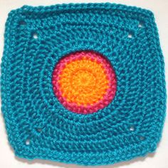 I AM...CRAFTY! Hooked on Granny Squares. Just love granny squares. And such a cheerful colorful variety!