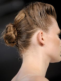 Odile Gilbert gave the Suno girls a structural twist in the front and a slick bun in the back.