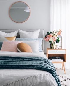 4 Principles for Creating the Perfect Bedroom Create the perfect bedroom according to these principles. White, teal and blush pink bedroom with a clean, minimal style.