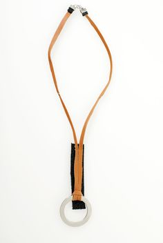 $54 City    My black and orange leather necklace with silver ring.