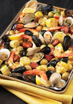 Pan Clam Bake No need to head to the beach: this sheet pan preparation delivers the New England flavors of a classic clam bake to your kitchen anytime.Head On Head On may refer to: Seafood Bake, Seafood Dinner, Fish And Seafood, Fish Recipes, Seafood Recipes, Cooking Recipes, Healthy Recipes, Healthy Meals, Canned Clam Recipes