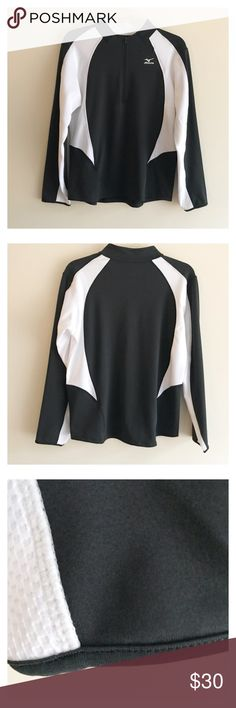 Men's Mizuno athletic shirt Men's Mizuno athletic shirt size XL. Near perfect condition. There is one tiny pick the size of a fuzzy pil on the back. Hard to see. Has a small pocket on chest near shoulder. Mizuno Shirts Tees - Long Sleeve