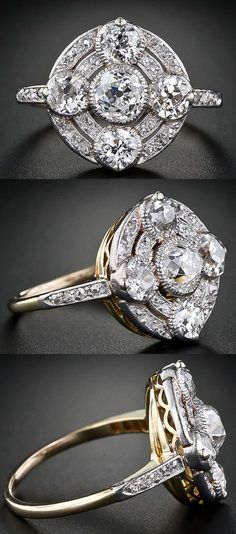Circular antique diamond ring from the early 1900s.  Five antique old mine-cut diamonds - the central diamond weighing a half-carat - are presented atop glittering concentric circles. The setting is plantinum over gold.
