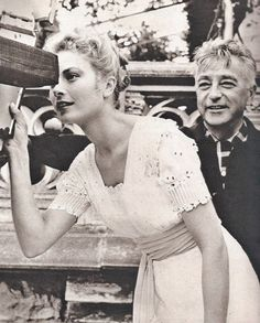 Grace Kelly and director Charles Vidor on the set of The Swan, 1956.