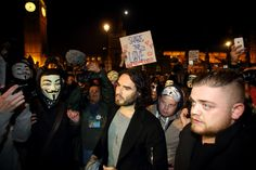 Russell Brand joins the protestors in Parliament Square during the Million Mask March on November 5, 2014 in London, England. Protestors with covered faces marched from Trafalgar Square to Parliament Square and then around the streets of London in protest against austerity, mass surveillance and attacks on human rights.