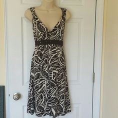 """Brown Dress (M- 10) Leaf printed brown/cream Dress. V-cut in the front and back. 38"""" long  Armpit to armpit measured flat 19"""" Waist 17"""" Material does stretch. 95%Viscose, 5%Elastane Dresses Midi"""
