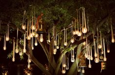 dangling wedding deco / candles in the tree