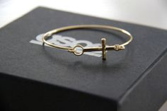 ♥ the simplicity of this sideways cross bracelet