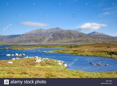 Looking across Loch Druidibeg to Hecla and the hills of South Uist, Scotland Stock Photo