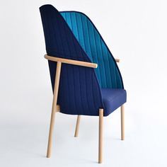 """This chair has a backrest """"like a shirt collar""""."""