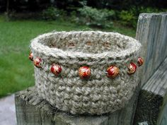Beaded Jute Basket - free pattern on Ravelry.  Off to Lowe's to buy some jute string.