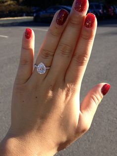 My 1 carat pear shaped engagement ring...proposed by my fiancé in Napa valley...in love!!!
